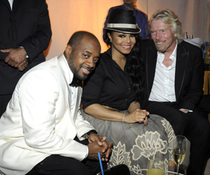 Jermaine Dupri, Janet Jackson and  Sir Richard Branson  Photograph by: Getty Images/Atlantis, The Palm