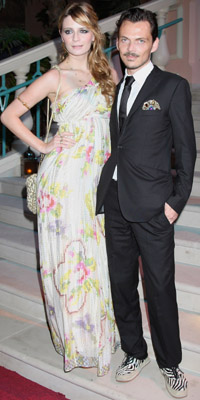 Actress Mischa Barton and designer Matthew Williamson   Photograph by: Getty Images/Atlantis, The Palm