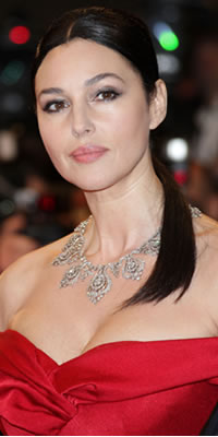 Actress Monica Bellucci wearing Cartier jewellery attends the Don't Look Back Premiere at the Grand Theatre Lumiere Photo by: Daniele Venturelli/WireImage