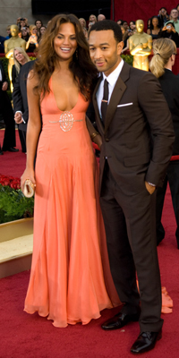 John Legend (right) and guest attend the 81st Annual Academy Awards®  Dress by:  Jon Didier / ©A.M.P.A.S.