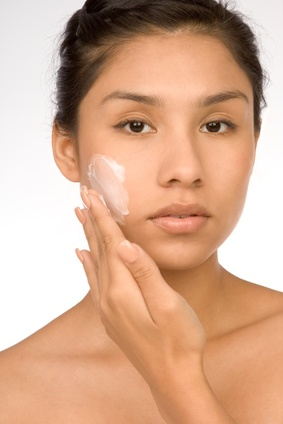 Picture of model putting on facecream used for webchat on anti-aging creams